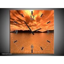 Wandklok op Canvas Zonsondergang | Kleur: Bruin, Oranje, Geel | F000260C