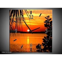 Wandklok op Canvas Zonsondergang | Kleur: Oranje, Geel, Bruin | F000276C