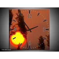 Wandklok op Canvas Zonsondergang | Kleur: Geel, Bruin, Oranje | F001389C
