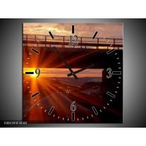 Wandklok op Canvas Zonsondergang | Kleur: Geel, Oranje, Zwart | F001393C