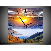 Wandklok op Canvas Zonsondergang | Kleur: Oranje, Blauw, Bruin | F006115C