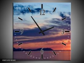 Wandklok op Canvas Zonsondergang | Kleur: Blauw, Grijs, Geel | F001141C
