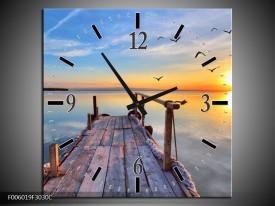 Wandklok op Canvas Zonsondergang | Kleur: Geel, Blauw, Grijs | F006019C